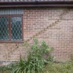 The picture shows cracking in the outside walls caused by ground subsidence